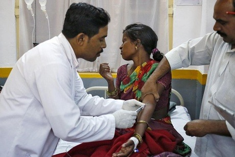 A hospital staff member at Chhattisgarh Institute of Medical Sciences hospital in Bilaspur, India