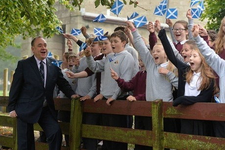 Scotland's First Minister Alex Salmond meets with pupils at a school in Strichen, near Aberdeen