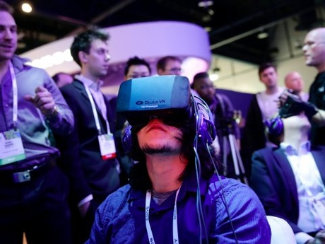 A man demos an early Oculus Rift prototype headset at the Consumer Electronics Show in Las Vegas