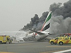 Emirates passenger jet with 300 on board crash lands at Dubai International Airport after catching fire in the air... and explodes on the runway