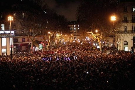 People gather to pay respect for the victims of a terror attack against a satirical newspaper, Paris
