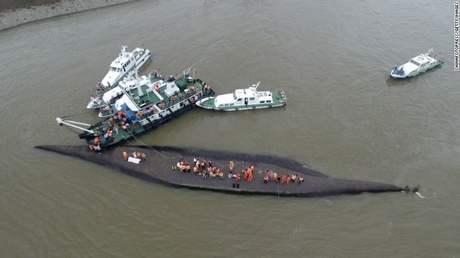 Rescuers search for survivors on June 2