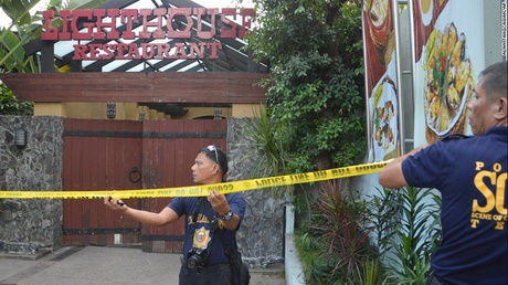 Police mark the crime scene with yellow tape where two Chinese diplomats were killed in Cebu