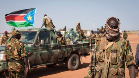 South Sudan's capital was rocked Sunday by heavy arms fire between forces loyal to the president...